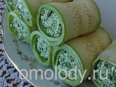 Zucchini rolls with nettles, nuts and cheese